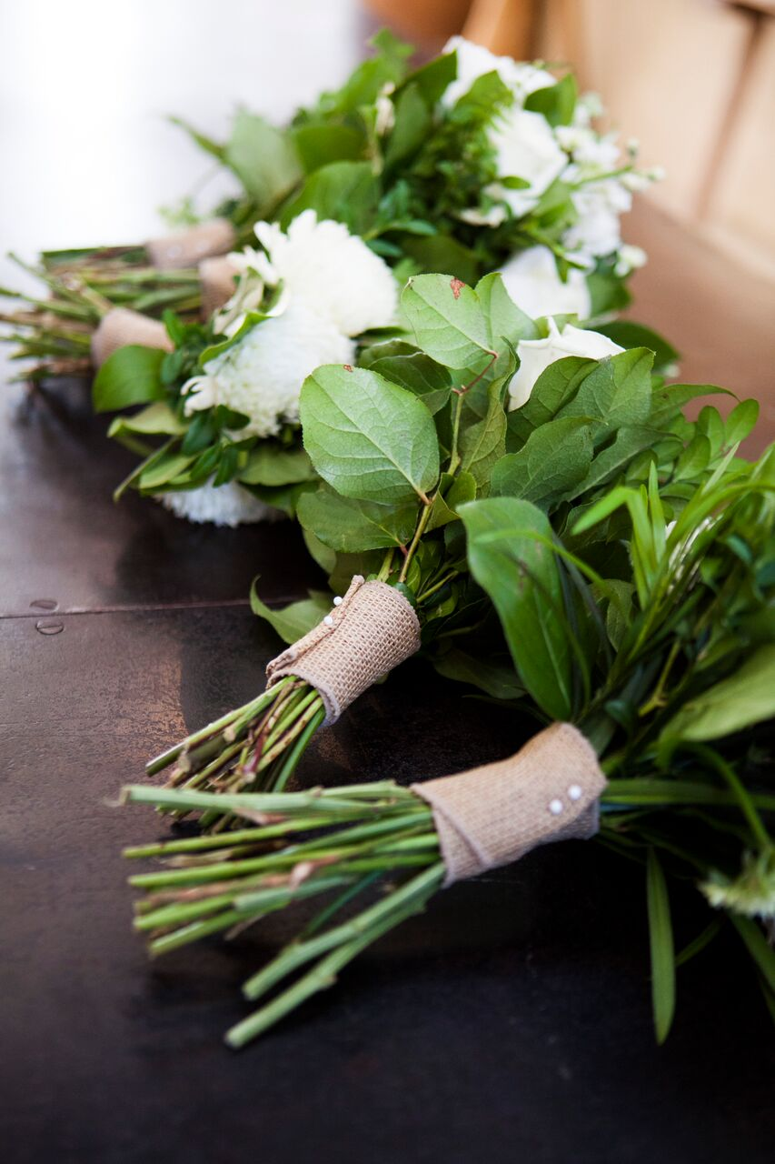 Simple burlap ribbon around bridesmaids bouquets  Planning By Wrap It Up Parties  Artifact Events