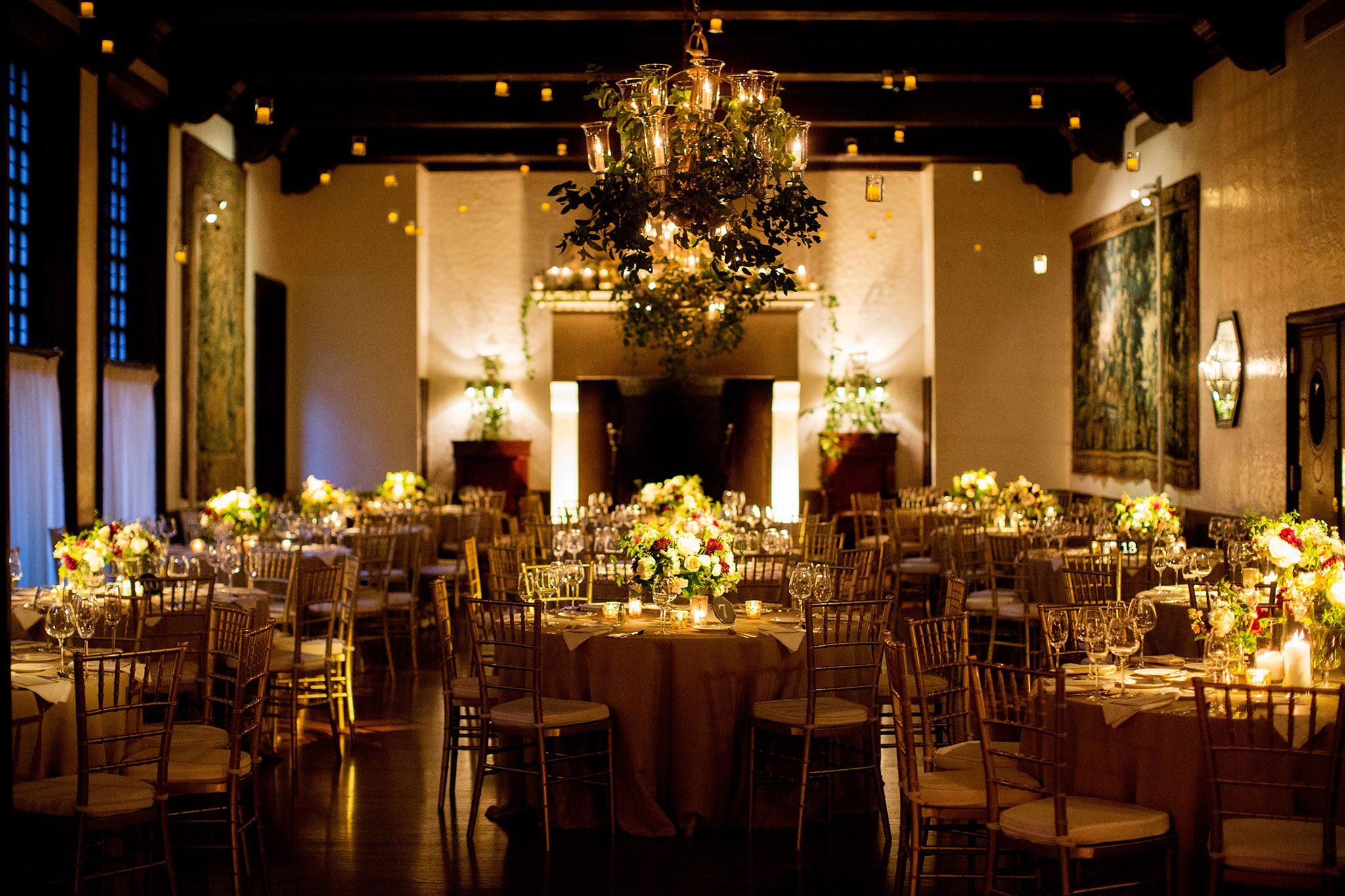 tea lights and votives hanging from the ceiling   Planning By Wrap It Up Parties