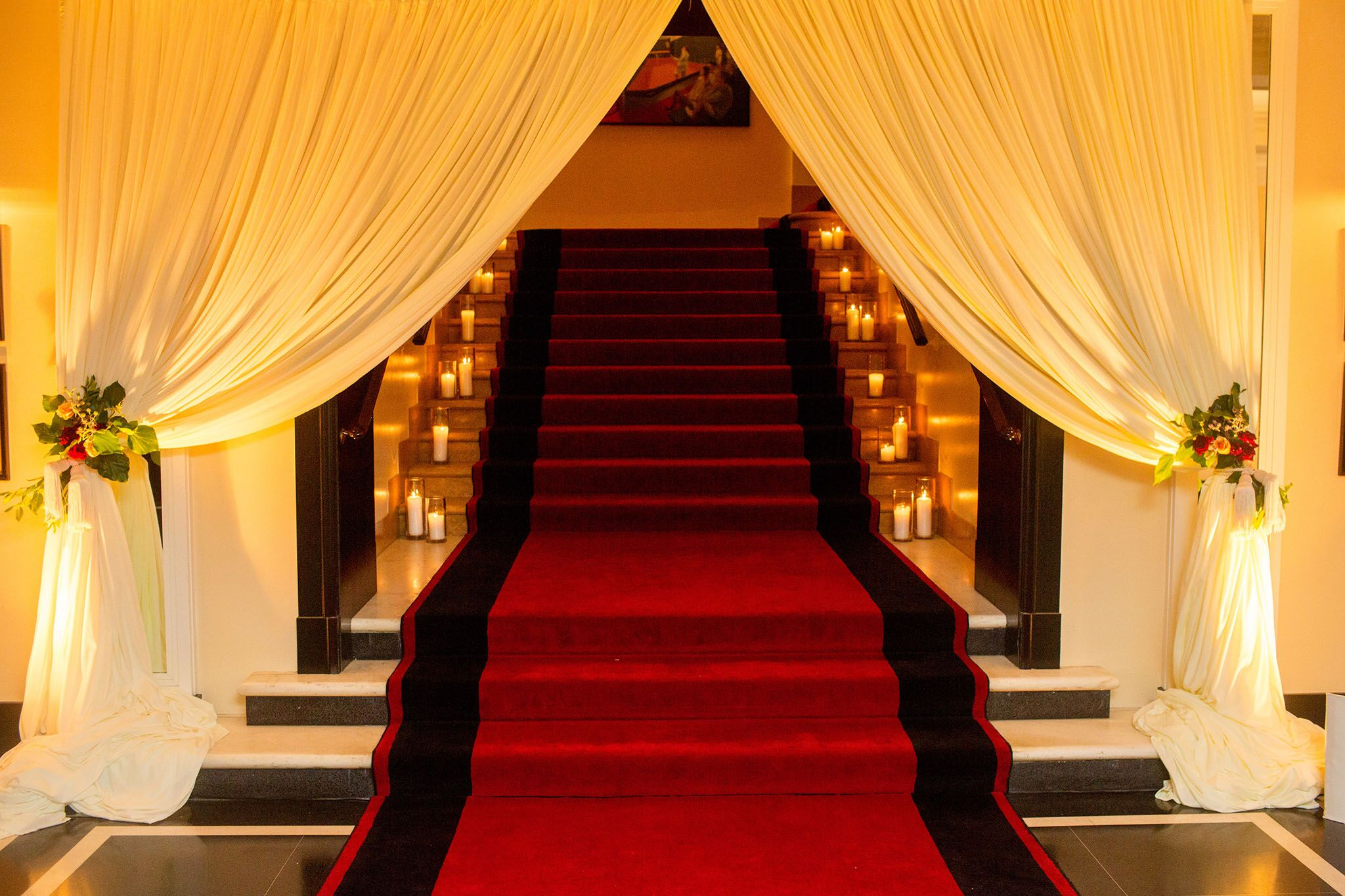 Draped and candle lit reception entrance to the Racquet Club of Chicago   Grand Reception Entrance   Planning By Wrap It Up Parties
