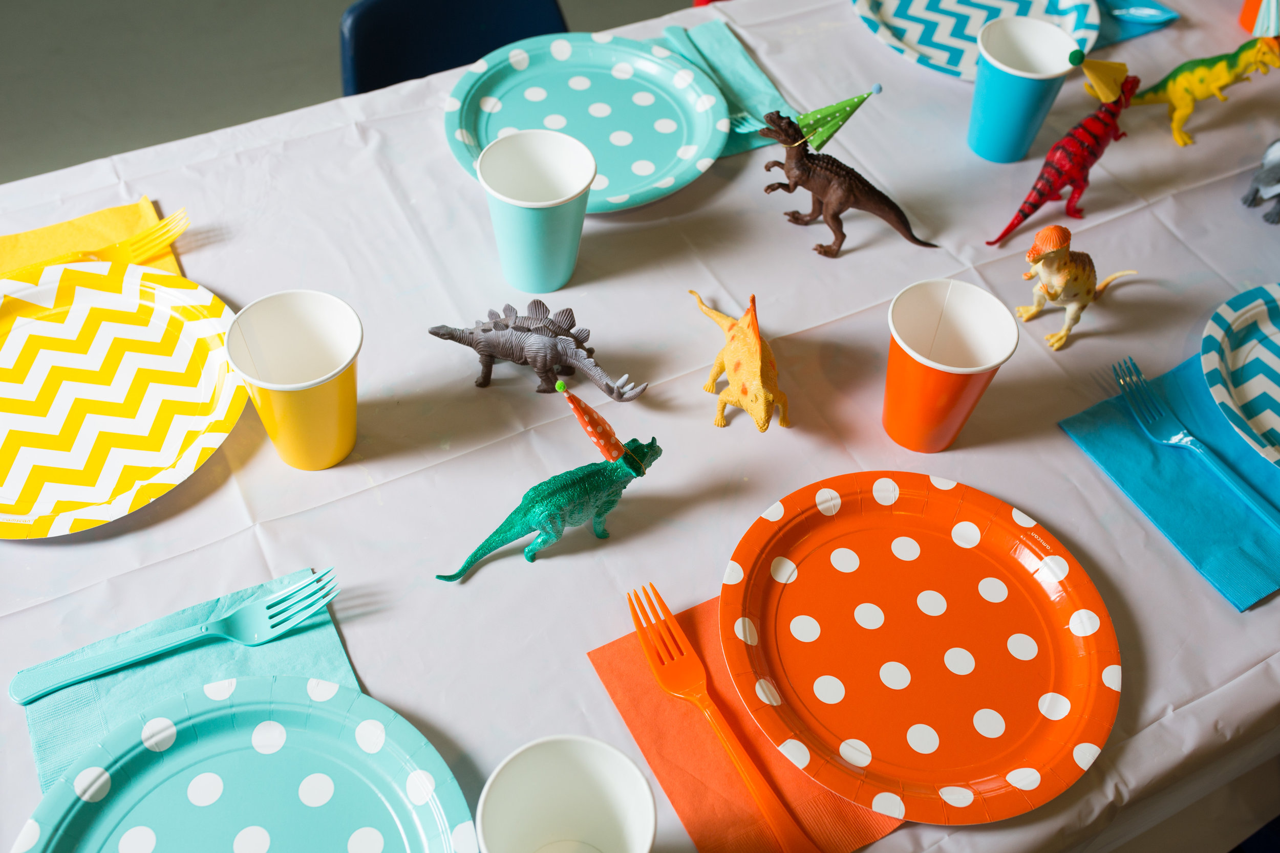 dinosaur theme first birthday, birthday boy, boy birthday party, boy birthday tables, Wrap It Up Parties