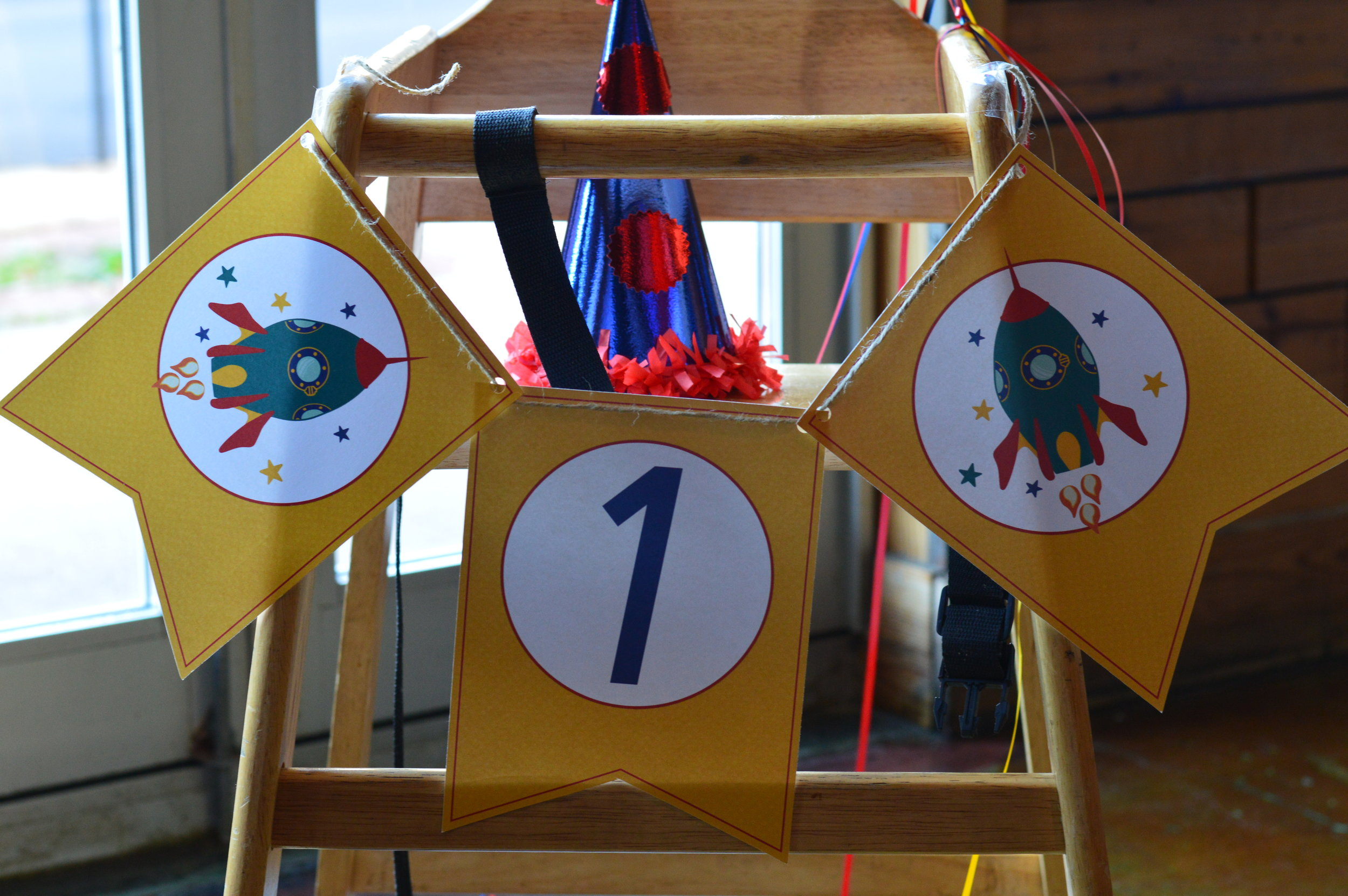space first birthday party, space decorated high chair, first birthday party, Wrap It Up Parties