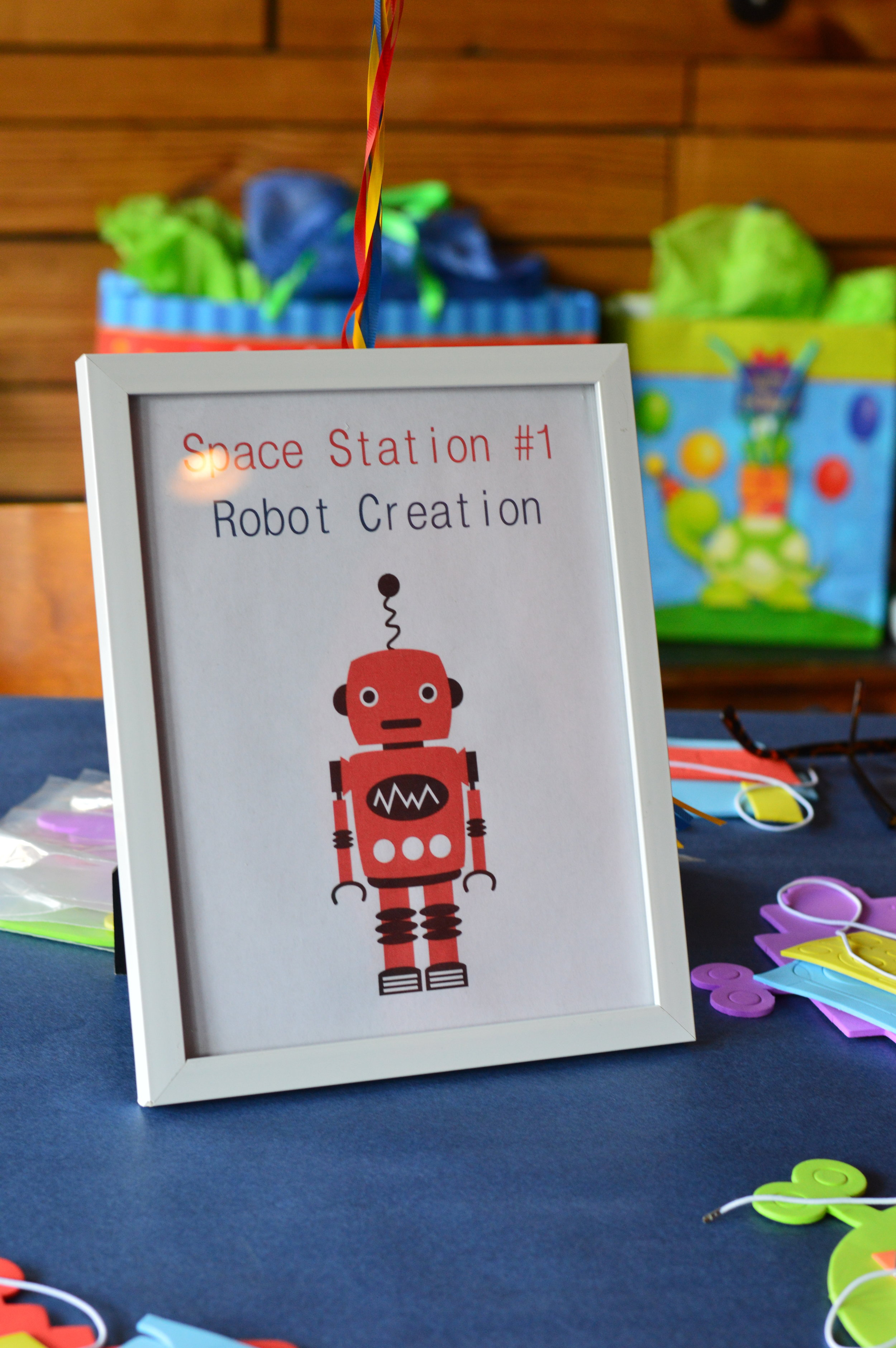 space first birthday party, create a robot, space decoration, Wrap It Up Parties