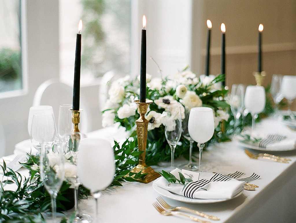 Greenery Filled Shower  Green and White Table Scape  Taper Candles   Planning by Wrap It Up Parties