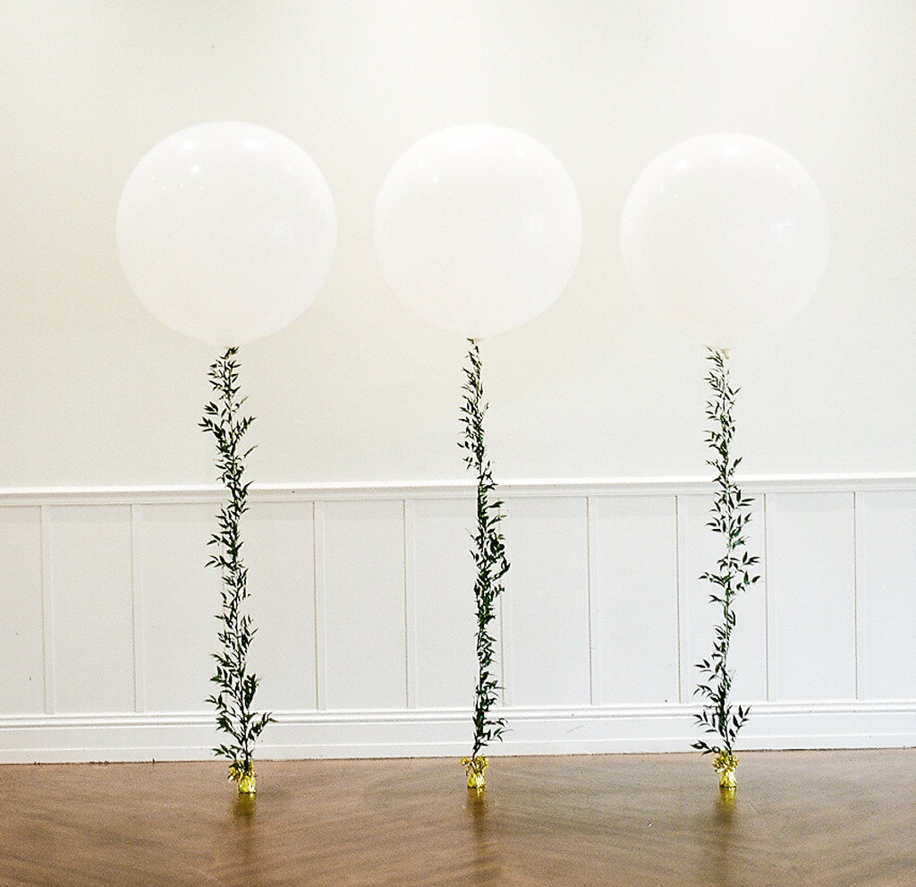 Greenery Filled Showers  White Balloon with Greenery  Planning by Wrap It Up Parties
