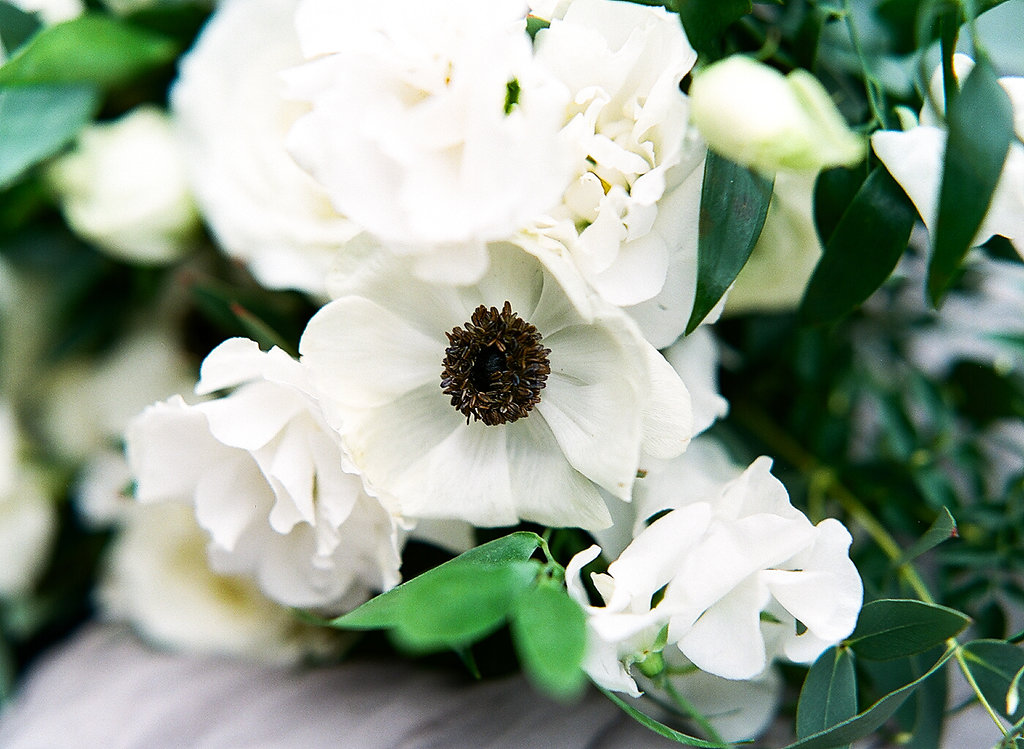 Greenery Filled Shower  White Flower Details  Planning by Wrap It Up Parties