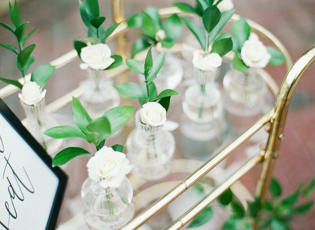 Greenery Filled Shower  Drink Cart  Green and White Shower Decor  Planning by Wrap It Up Parties