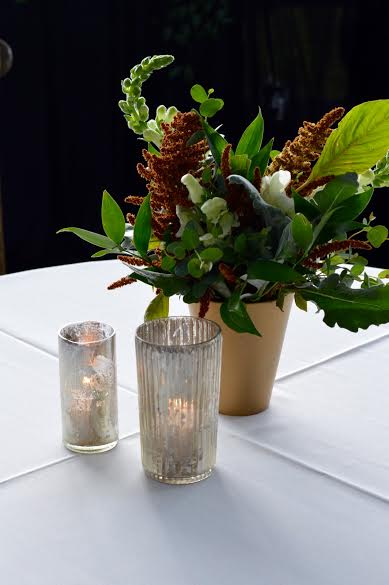 Celebration of Life  Green Centerpiece  Candle Accents  Planning by Wrap It Up Parties