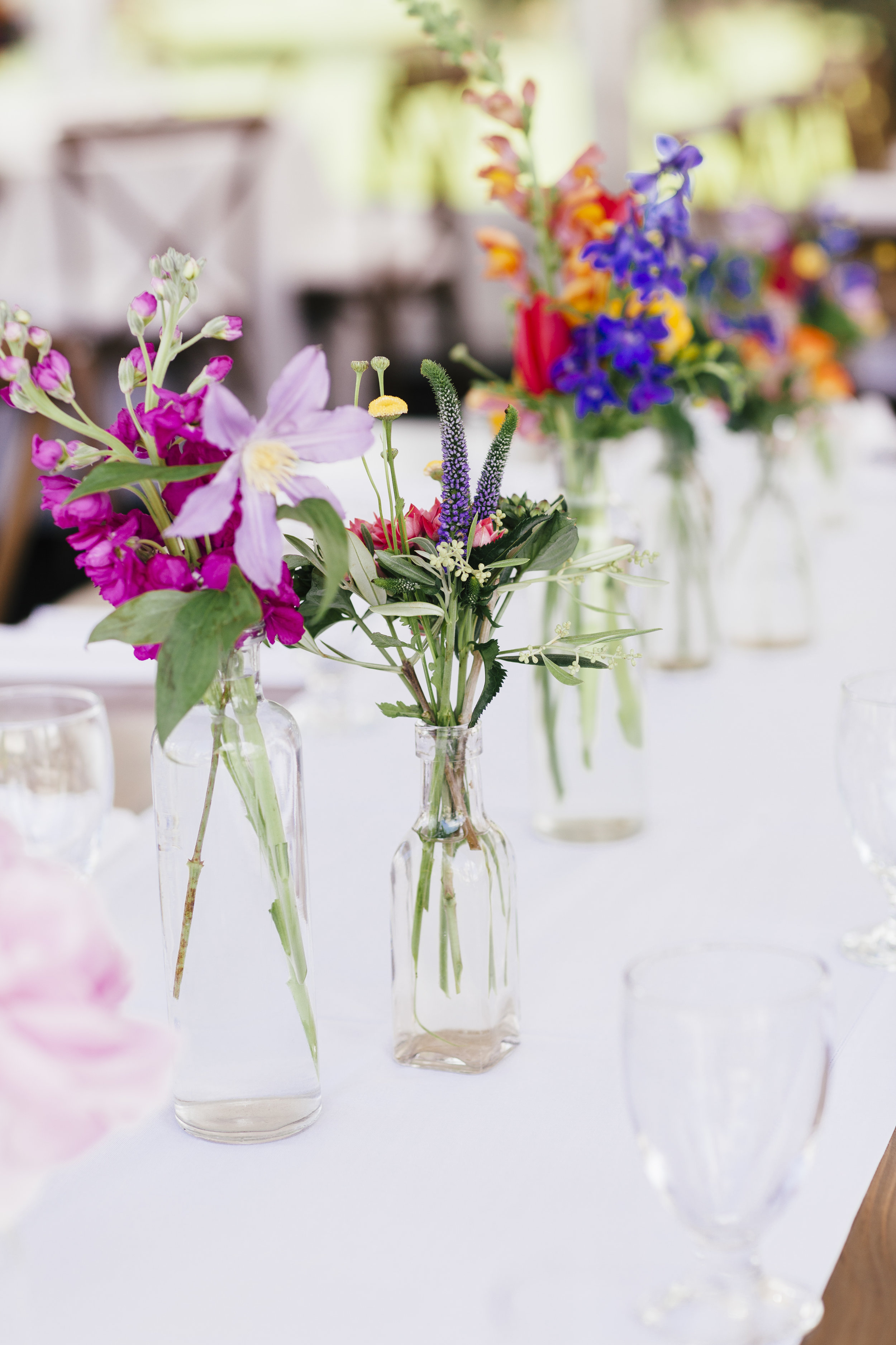 Private Residence Wedding  Colorful and Simple Floral Vases  Planning by Wrap It Up Parties