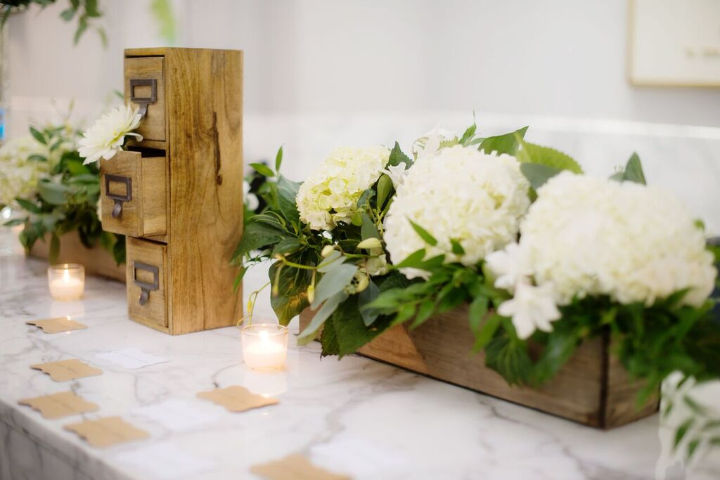 White Floral Decor  Planning by Wrap It Up Parties