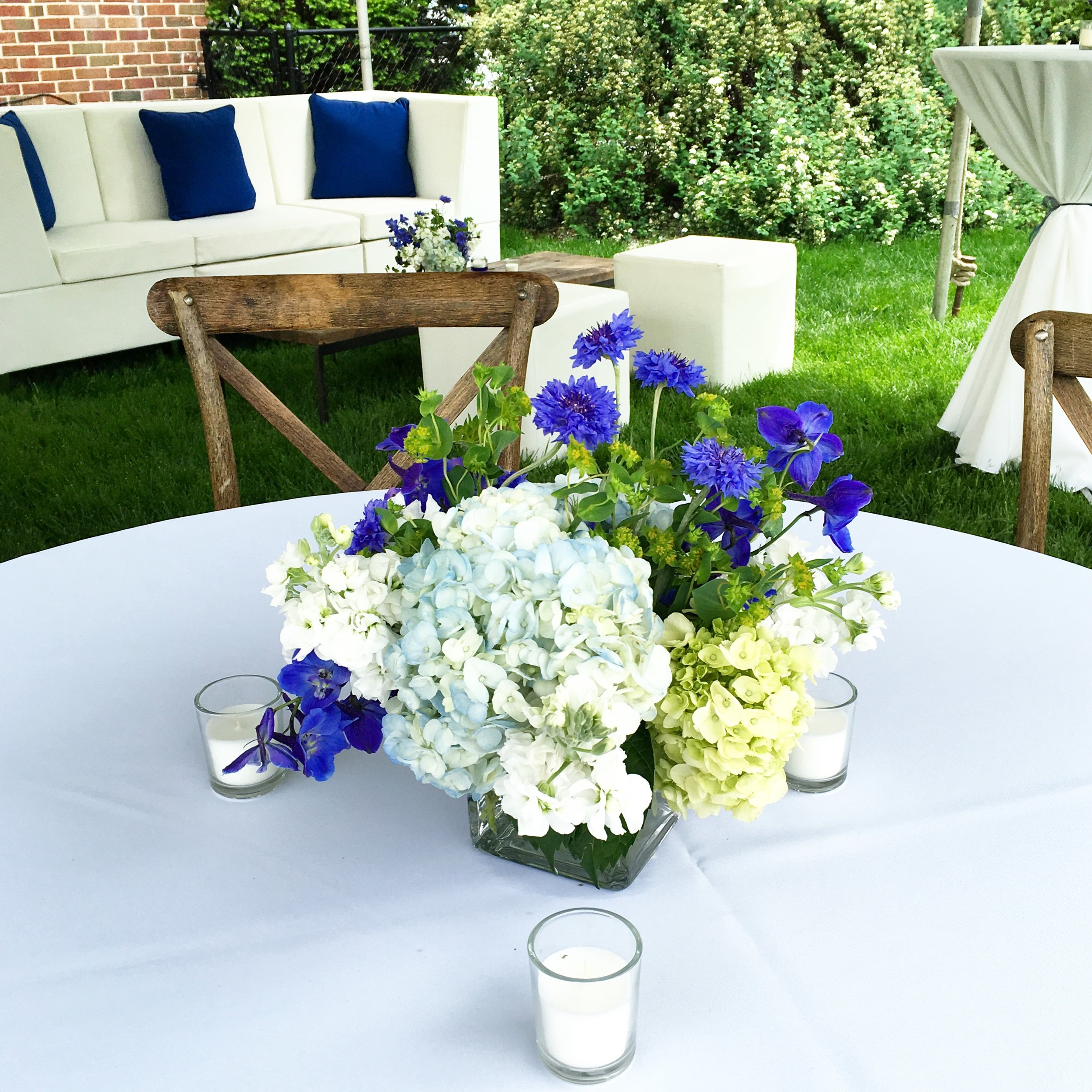 Backyard Graduation Party  Blue and White Centerpieces  Planning by Wrap It Up Parties