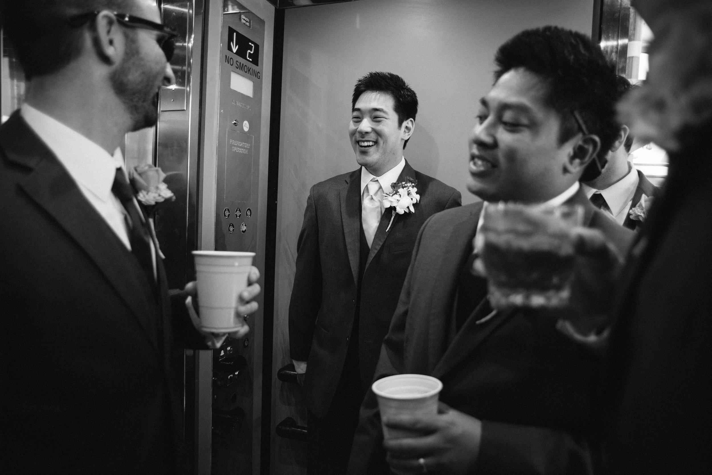 Groomsman in elevator