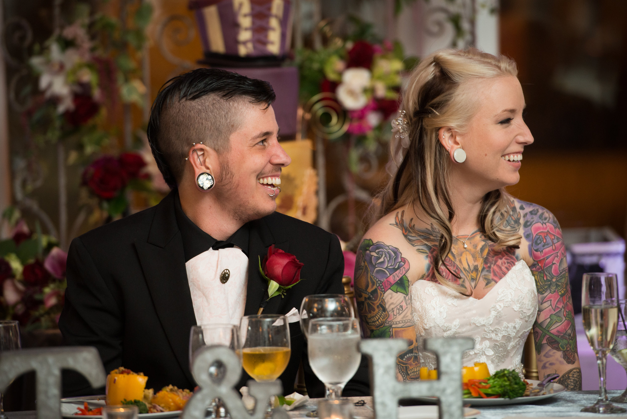 Couple laughing at speeches during reception