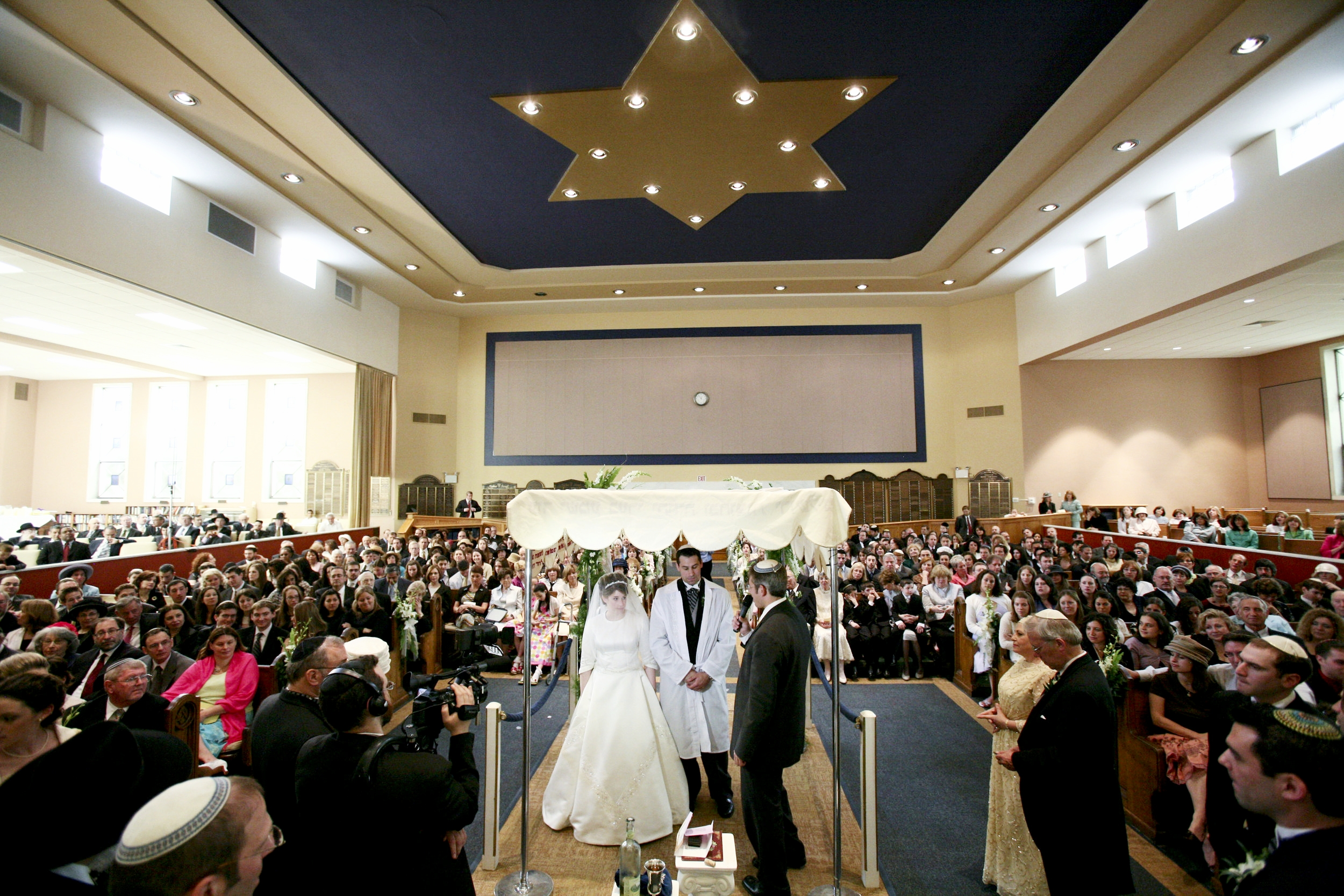 Wide shot of synagogue during Jewish wedding ceremony