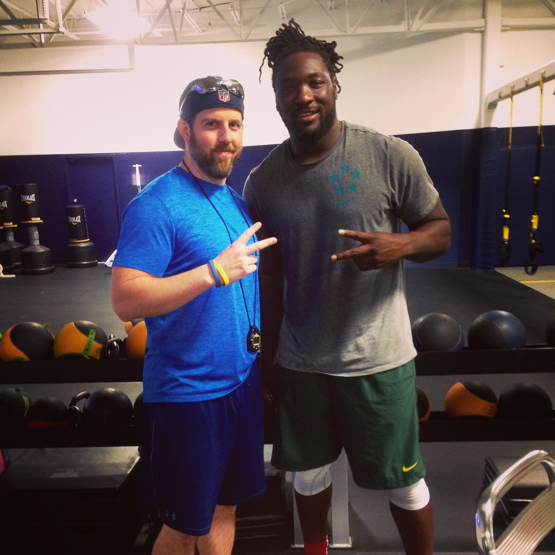 Strength coach Anthony Black (Left) with Running Back LeGarrette Blount After an Intense Session