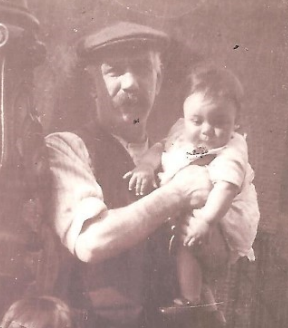 Arthur Wakefield, holding a baby.