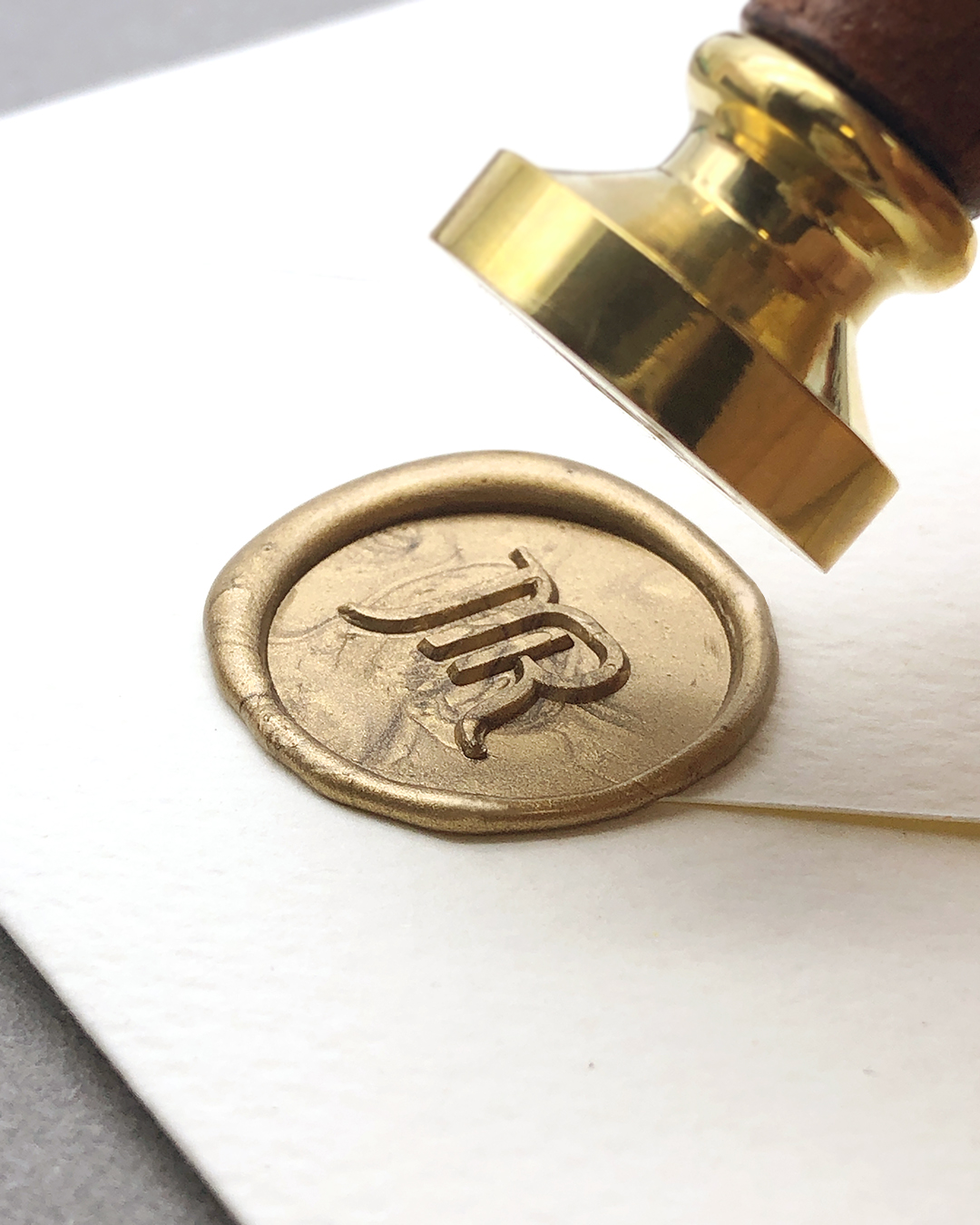 Learn to determine when the melted sealing wax is ready to be stamped