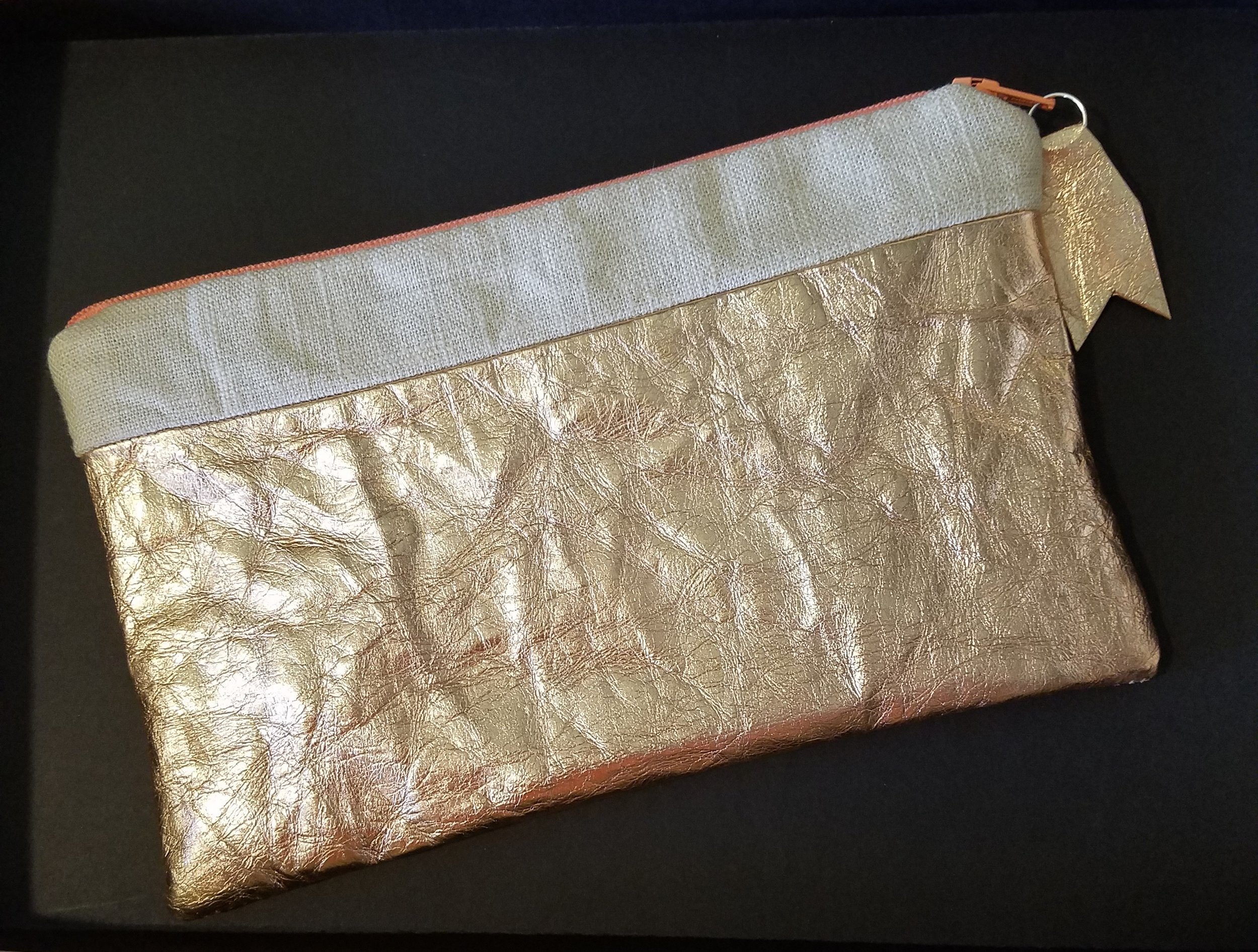 Rose Gold washable paper and linen zipper pouch.