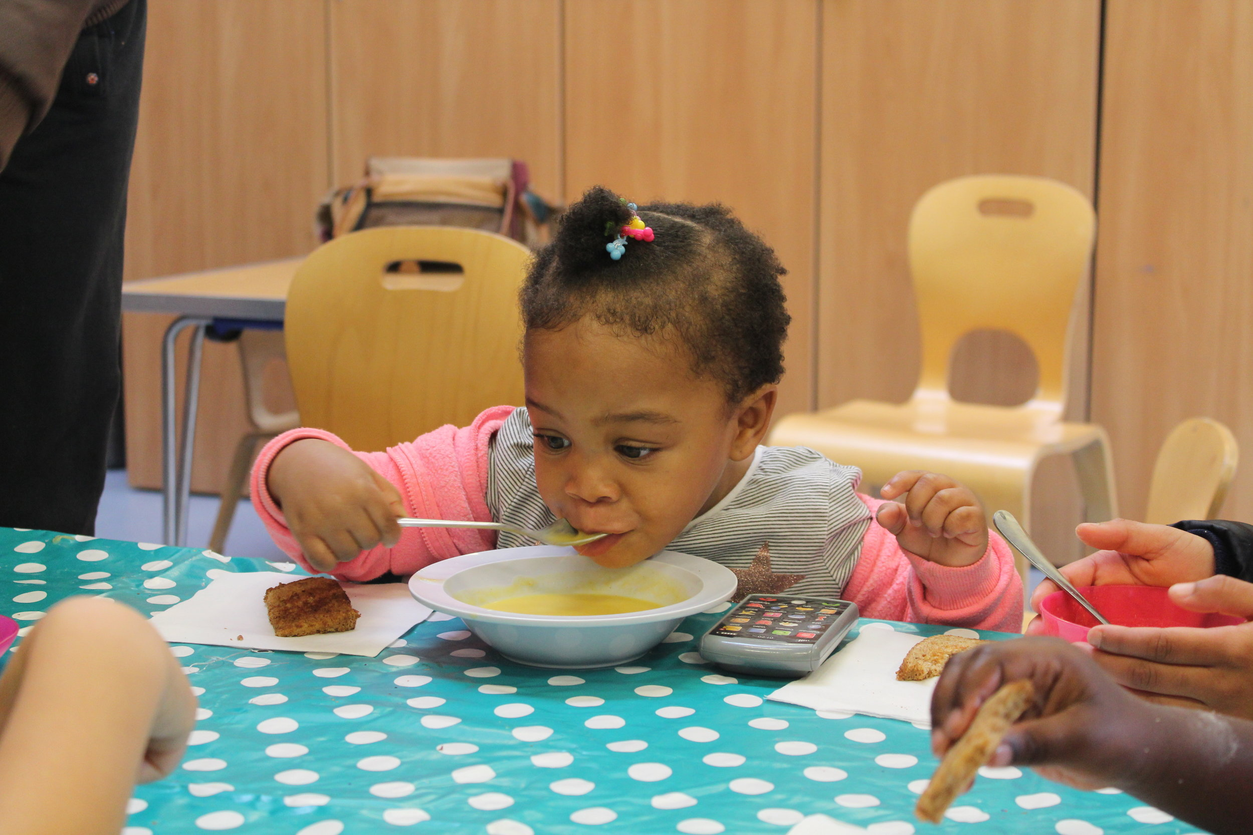 Enjoying pumpkin soup during October half term Stay & Learn session