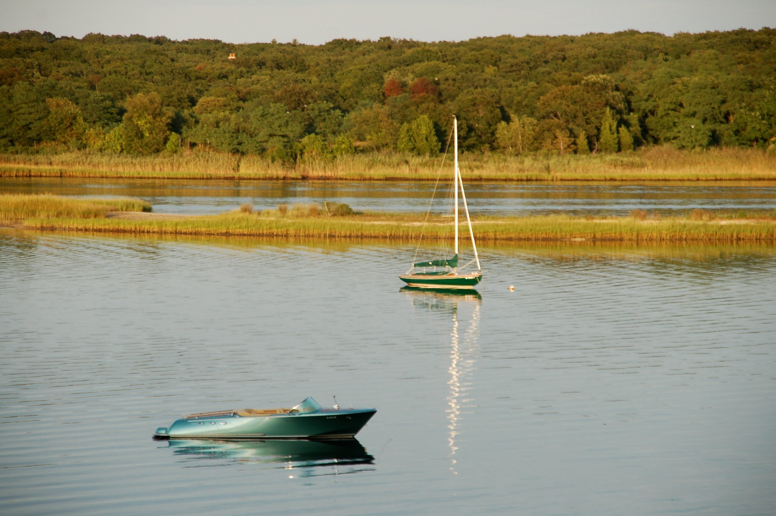 Classic motor and sailboats moored in Hampton Waters in front of our island