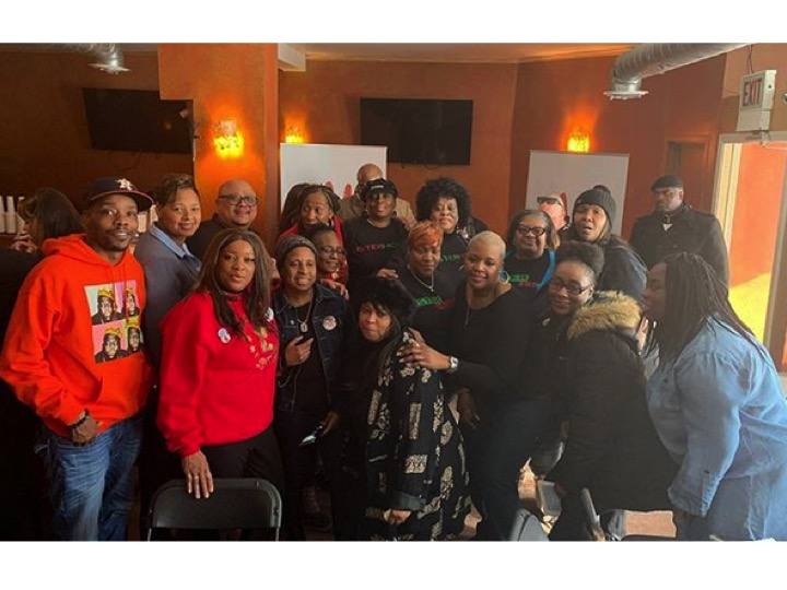 """Chicago Families who have been effected by Gun Violence pose together at an """"End Gun Violence Together"""" Event sponsored by Toms, Live Free and other local gun violence prevention organizations."""