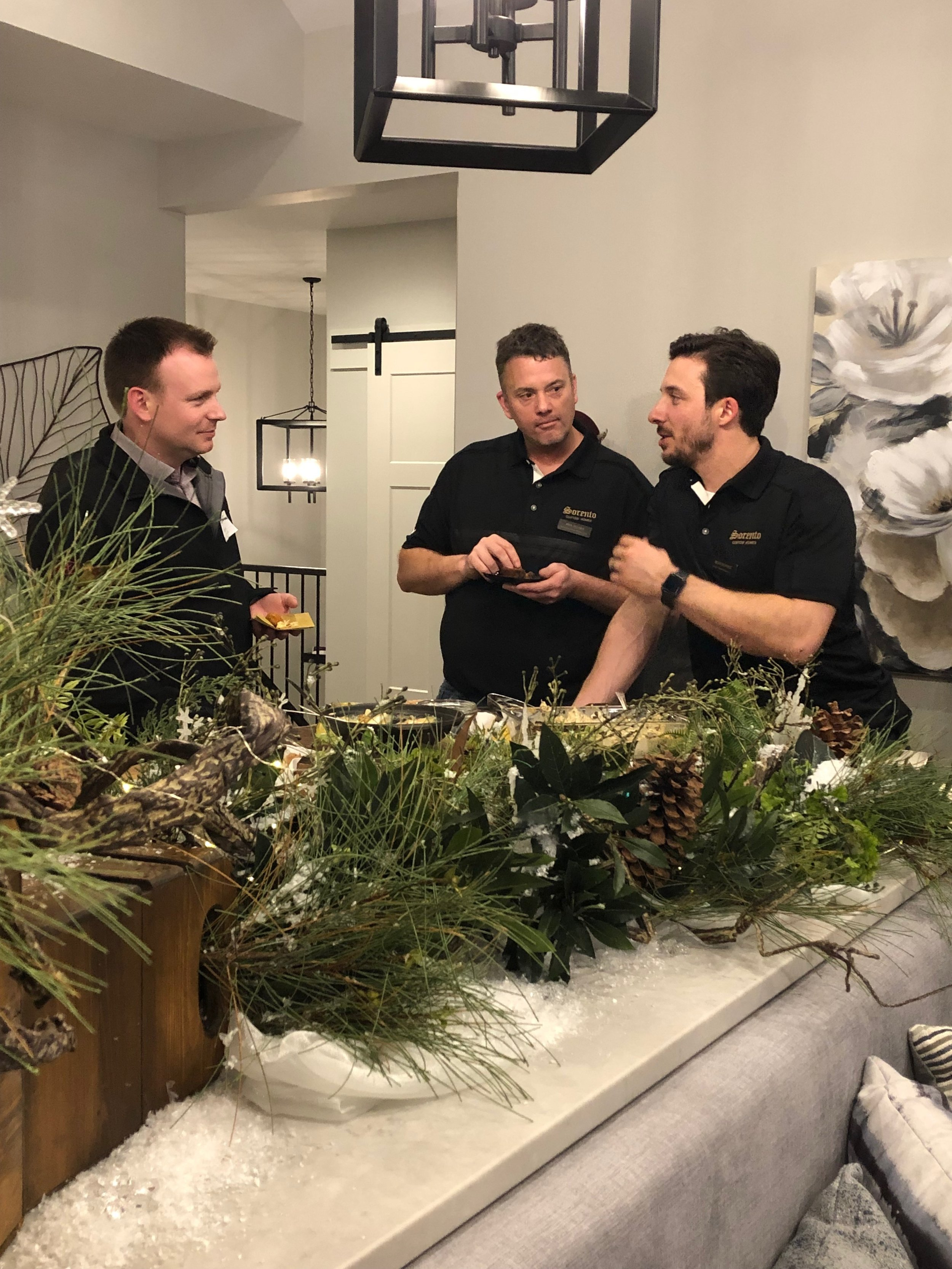 Rick and Mike, two of our superintendents, chatting with Kevin with  Aries Airflo , another one of our sponsors for the home.