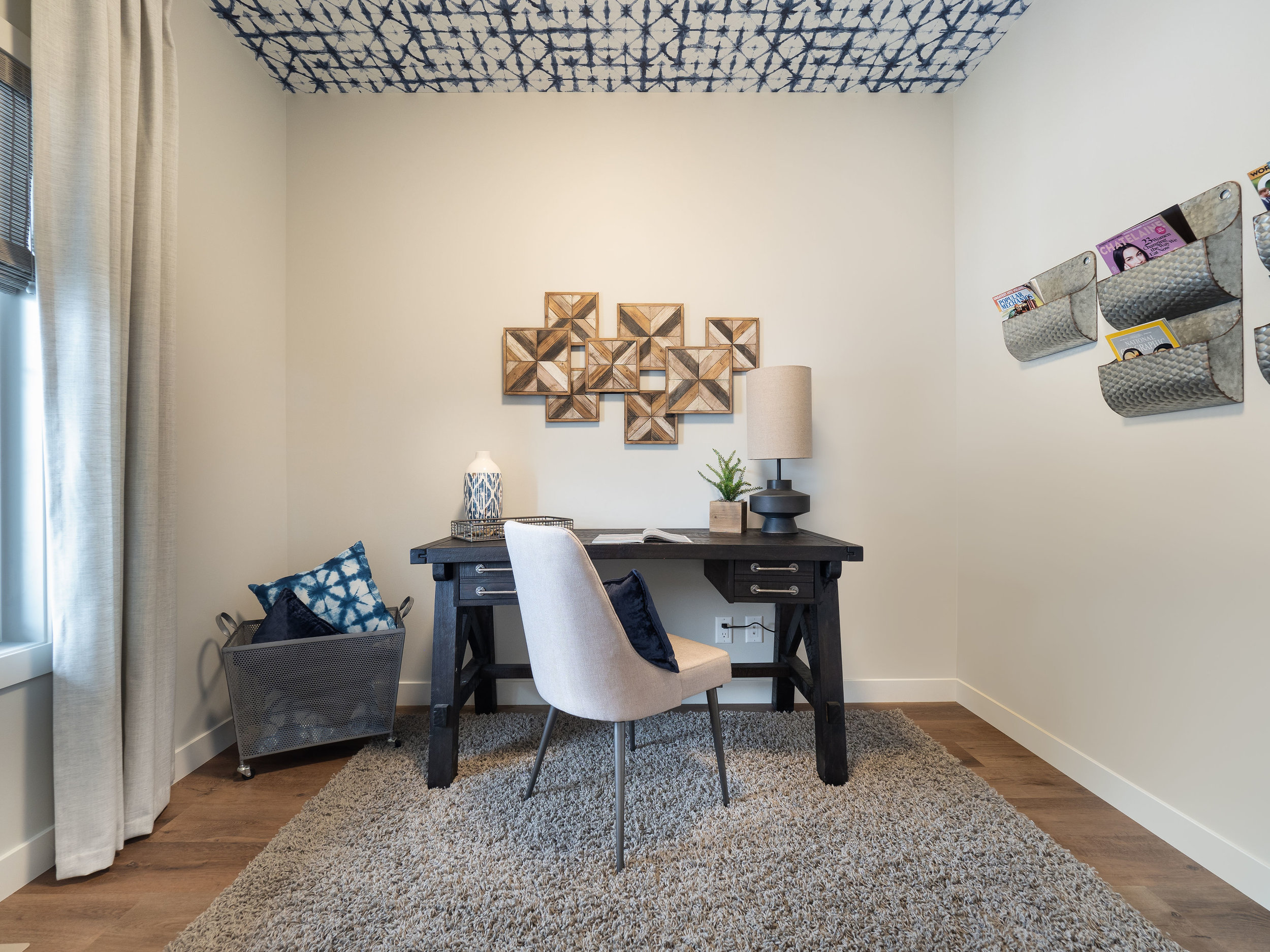 Our feature in the den was wallpaper, but on the ceiling. The blue theme was able to carry through when we found an abstract geometric pattern with a lot of impact in an otherwise quaint space. If wallpaper goes on the ceiling, is it REALLY wallpaper?