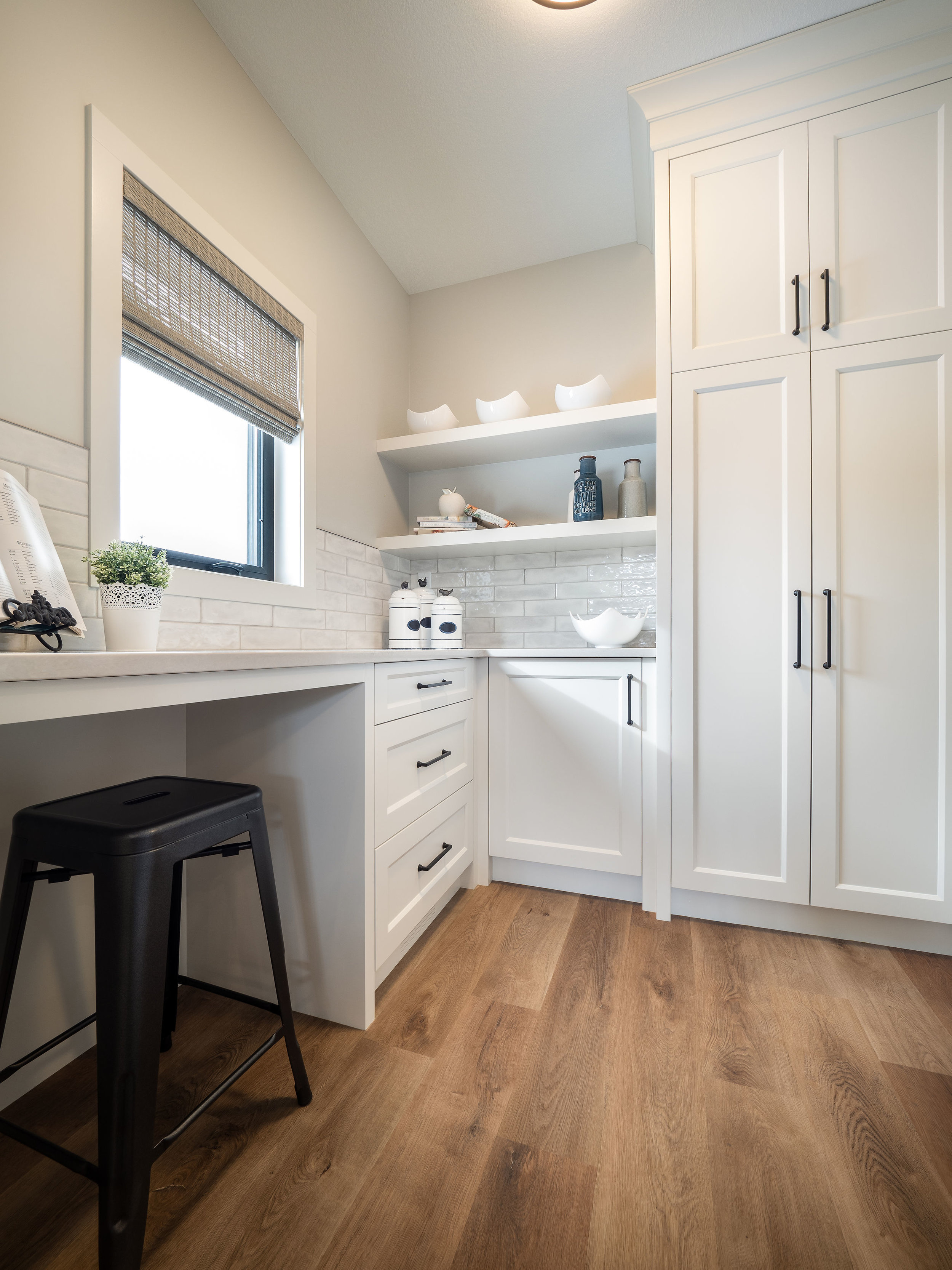 A walk through butlers pantry off the garage is the ideal location to unload those groceries and also function as a drop station.