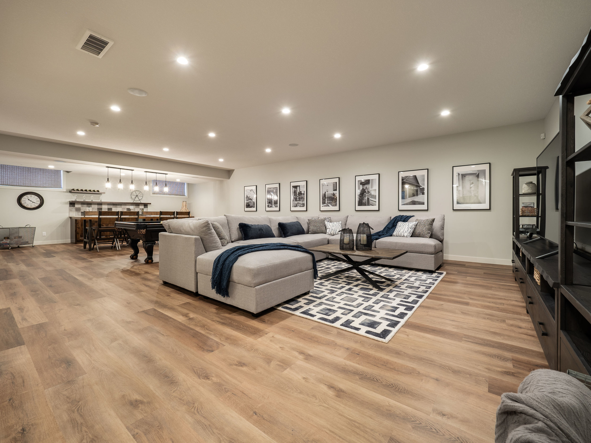 Bungalows always allow for those big basements. We kept this one as open as it gets, with a wet bar on one side and a over sized TV on the other. Movie nights never looked so good!