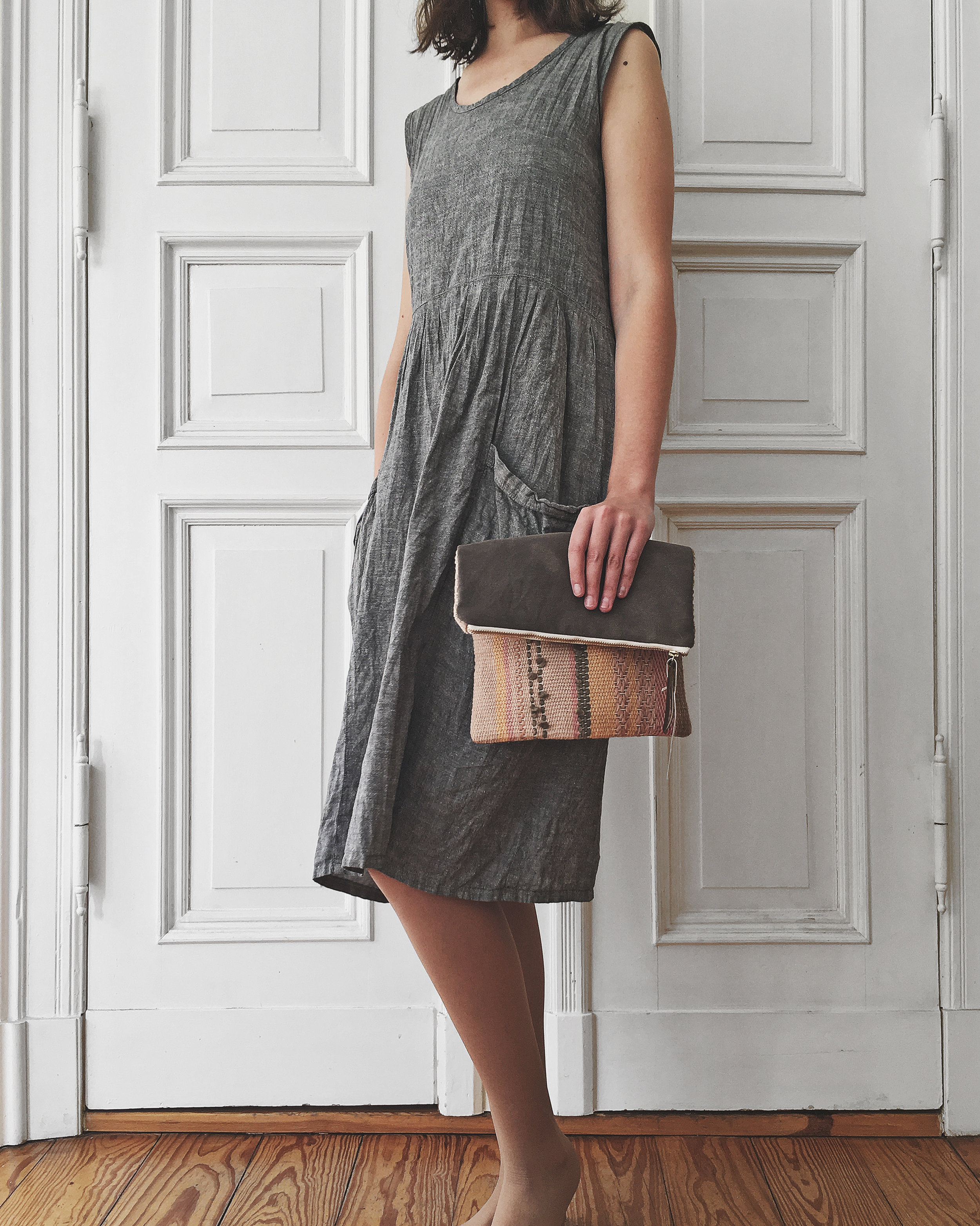 This reversible fold-over clutch was handwoven on a frame loom