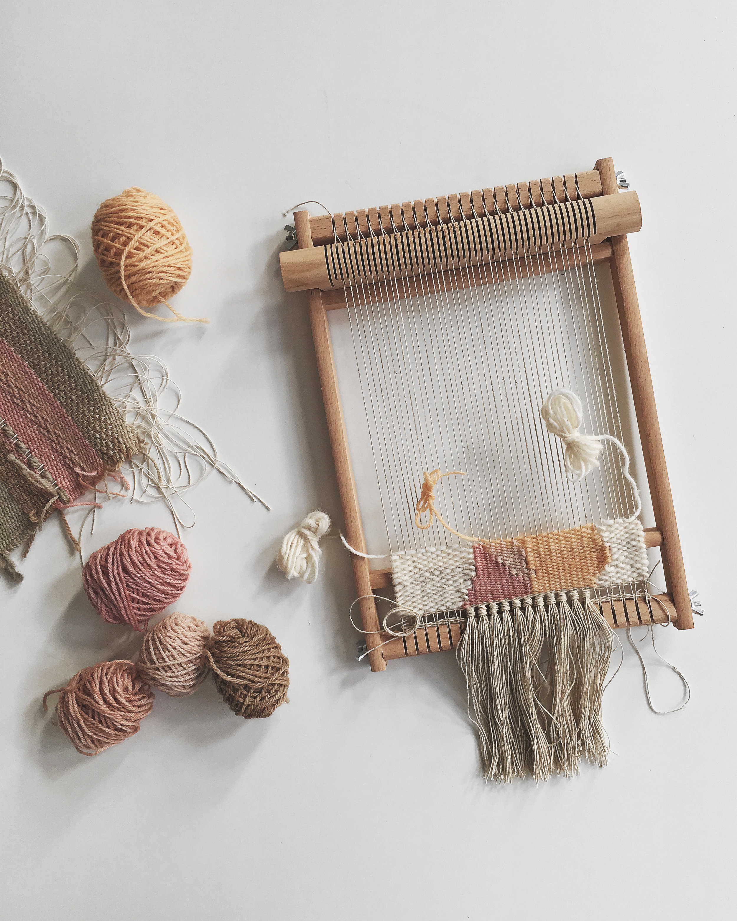 Handwoven tapestry on our adjustable tension frame looms made in Germany