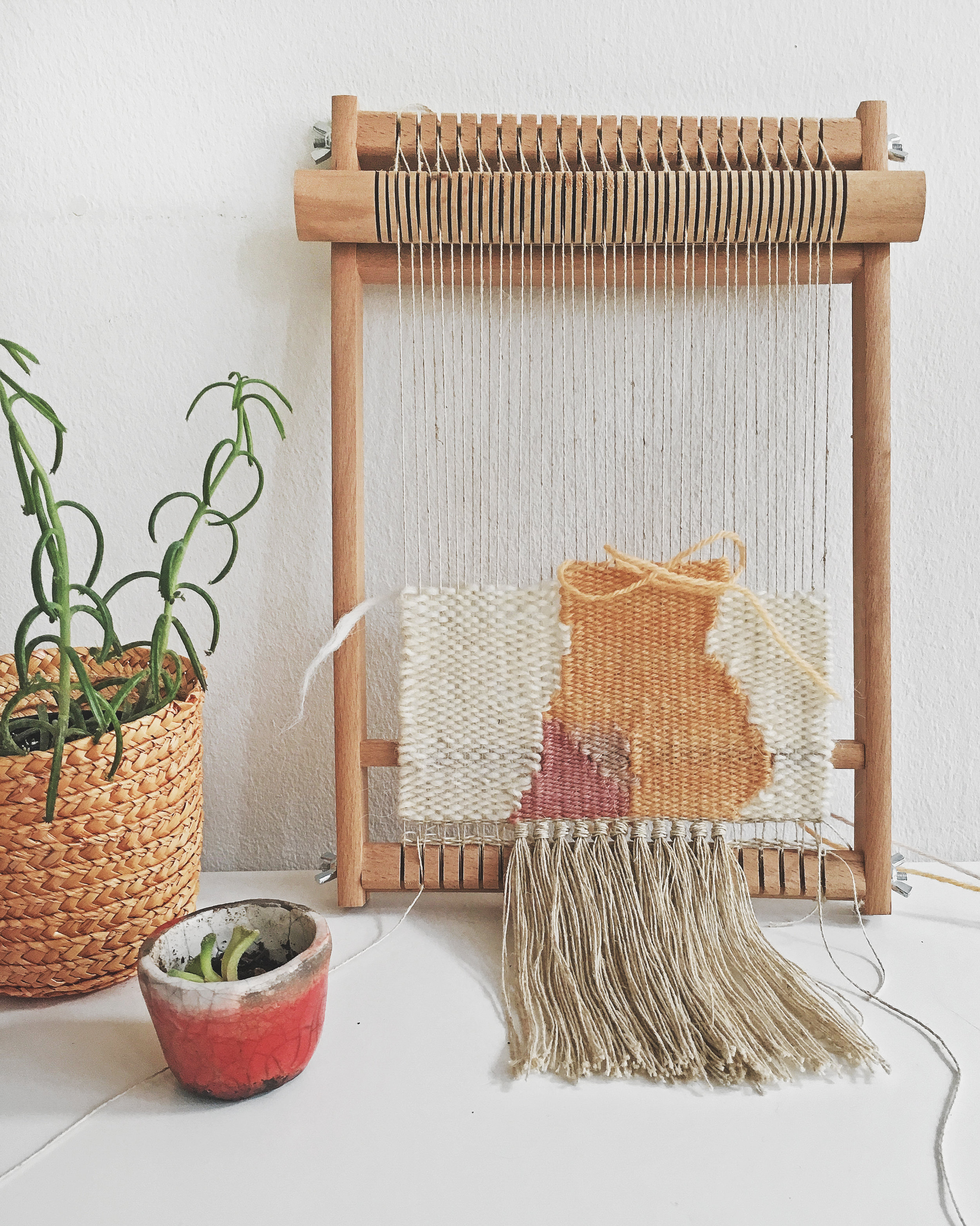 Showing up for a daily weaving practice on my frame loom with a heddle bar