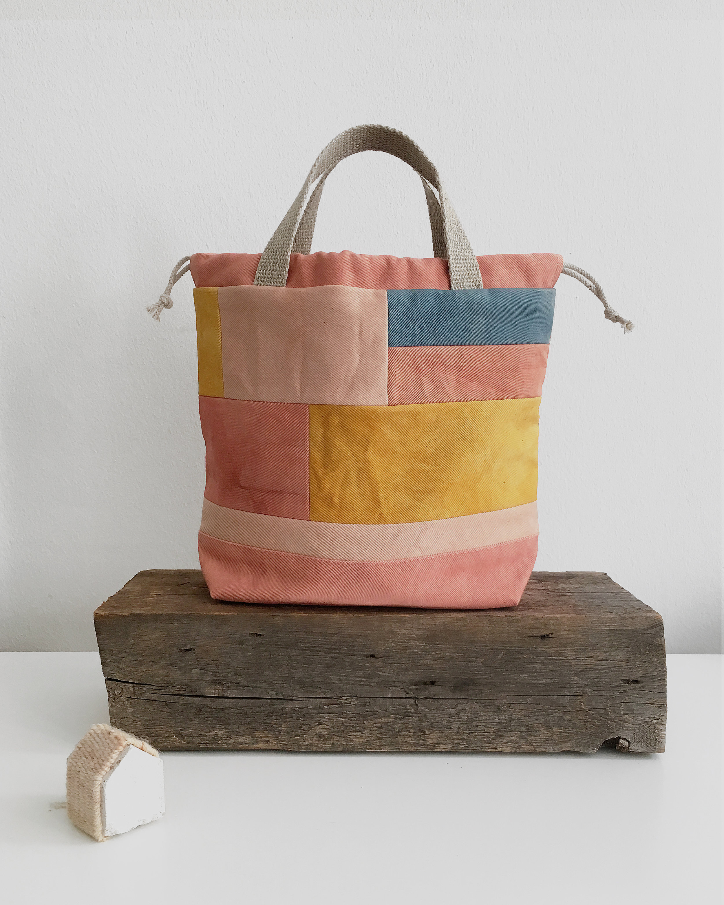Quilted project bag made with plant dyed organic cotton scraps