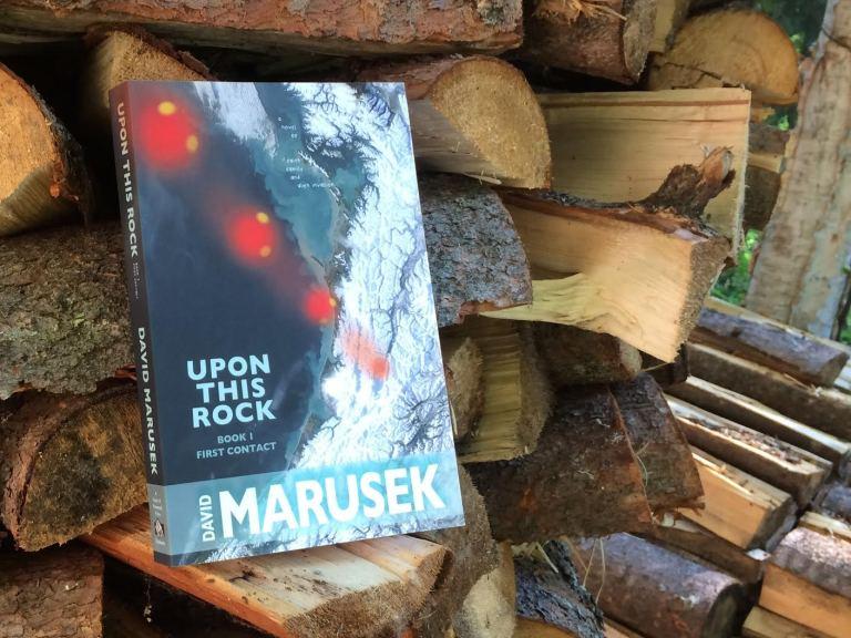 upon-this-rock_book-on-woodpile_david-marusek.jpg