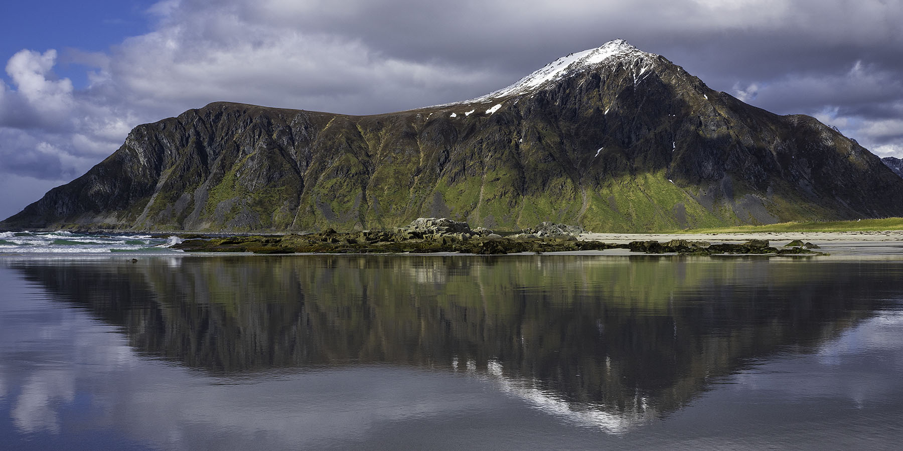 Mount Hustinden's reflection on the wet sand of Skagsanden beach - Flakstad, Lofoten Islands, Norway