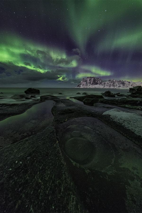 Northern Lights over the Dragon's Eye of Uttakleiv -Lofoten Islands, Norway
