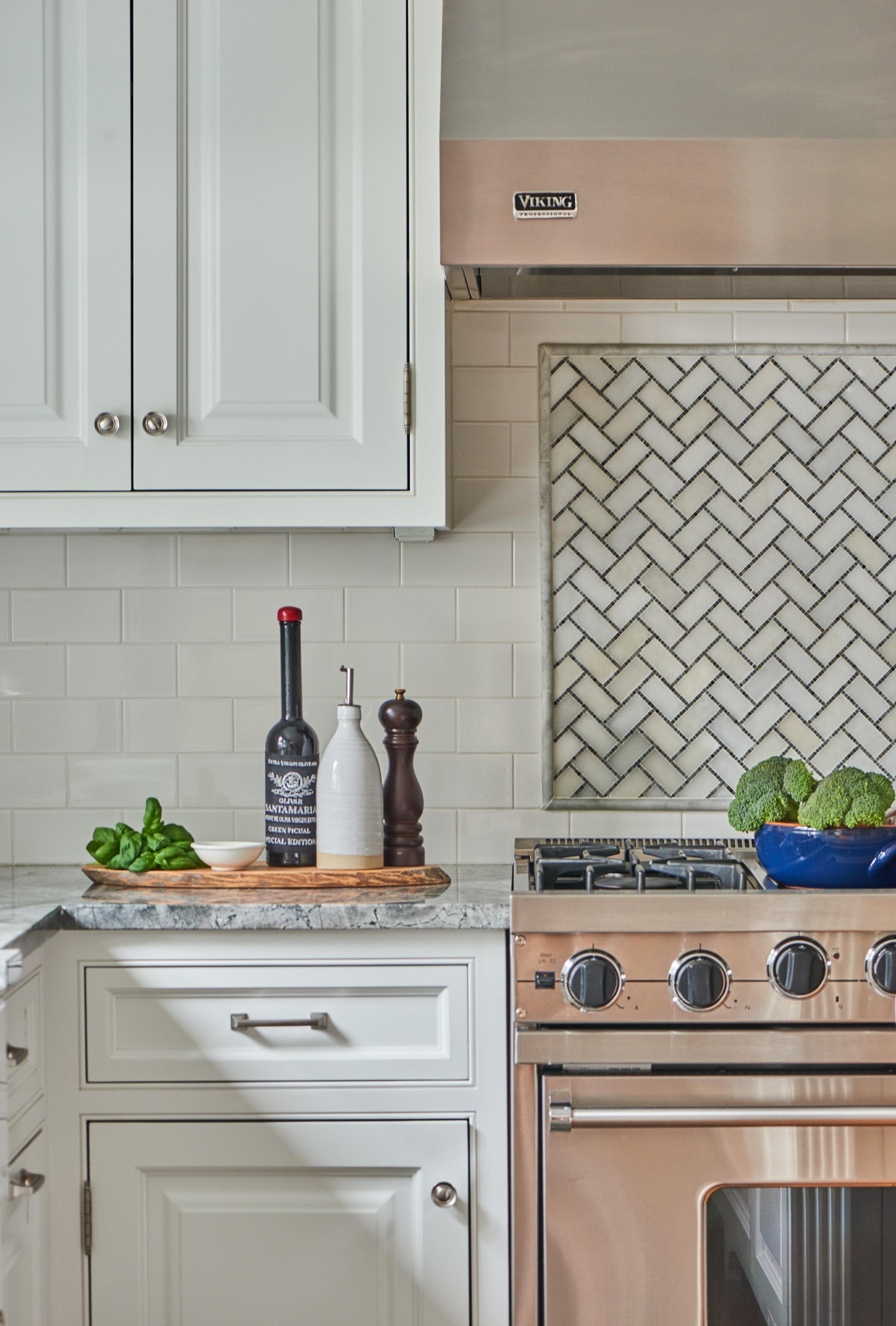White marble with custom-tiled backsplash