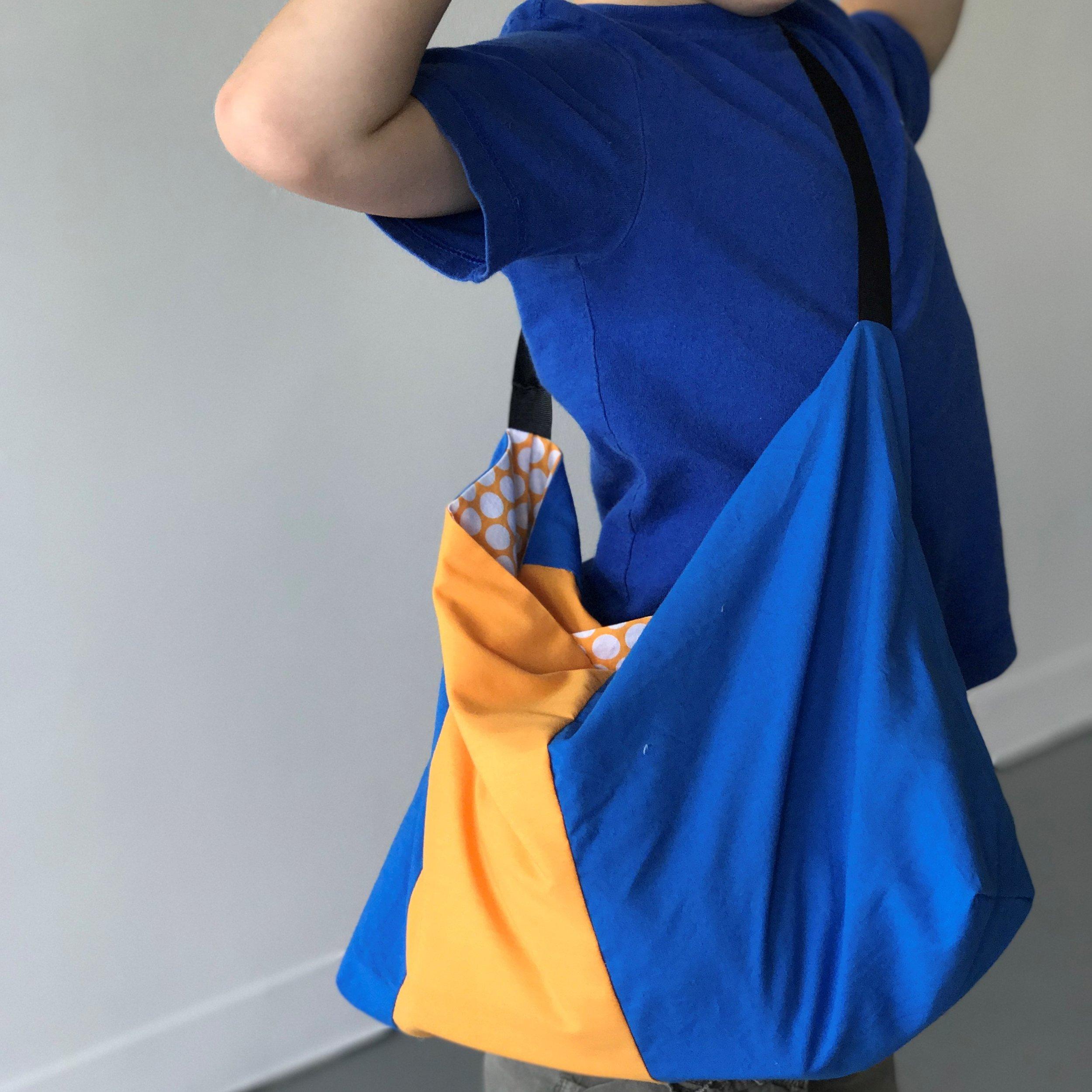 Triumphant boy with his custom bag that goes everywhere.