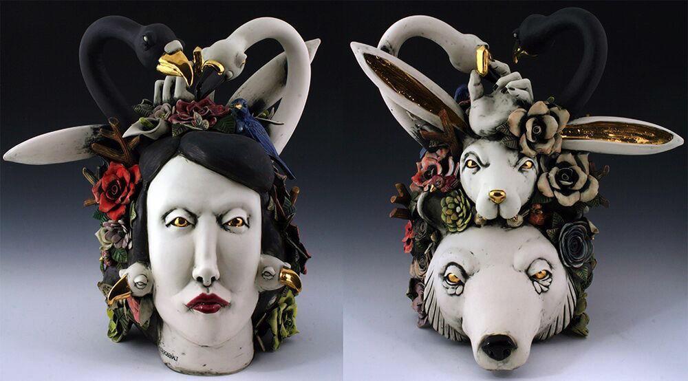1. Contrasting Swans  H25'' x W14'' x L 13'', porcelain, under glaze, glaze and luster $2500.jpg
