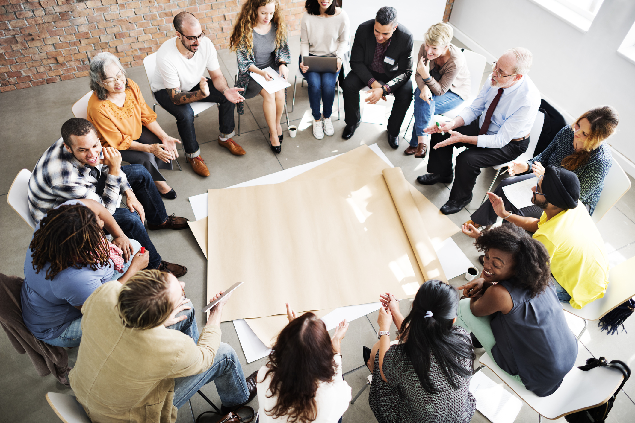 Workplace group sitting in circle for workshop