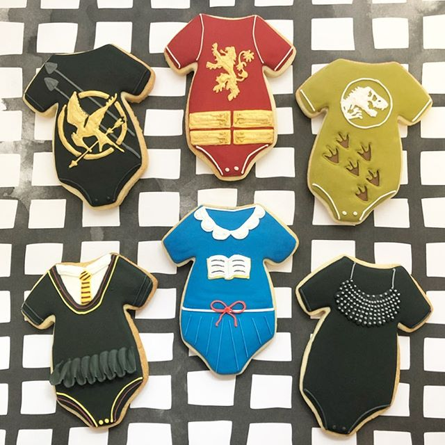 Onesies inspired by famous (real and fictional) women. Can you guess who they represent? #thefutureisfemale #babyshowercookies #womenempowerment #women #babygirl #babygirlcookies #baking #sugarcookies #cookies #decoratedcookies #decoratedsugarcookies #edibleart #customcookies #cookieart #cookiedecorating #cookiesofinstagram #instagood #royalicing #thisisCLE #CLE #mksweetsco