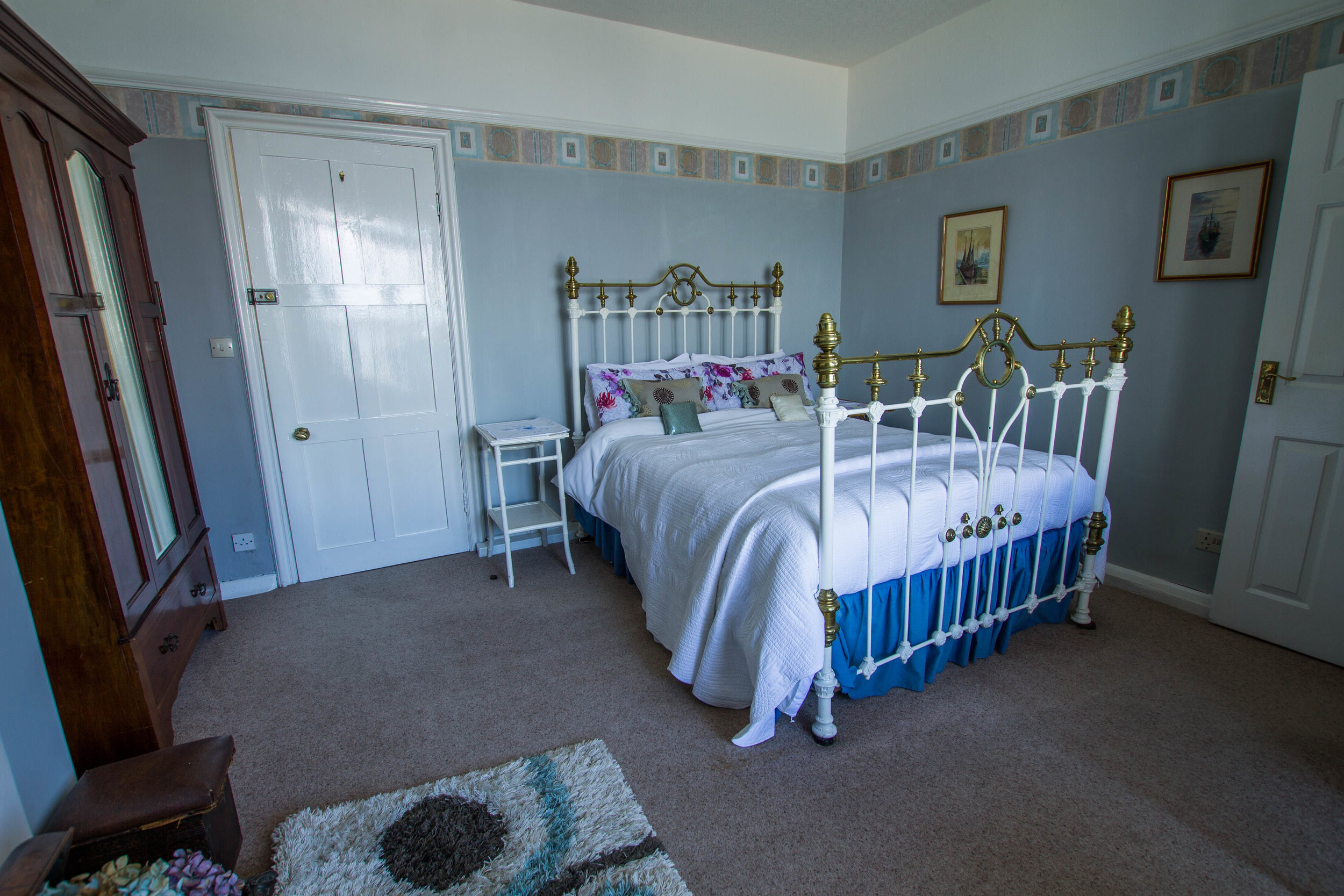 Our spacious double bedroom with beach views and balcony