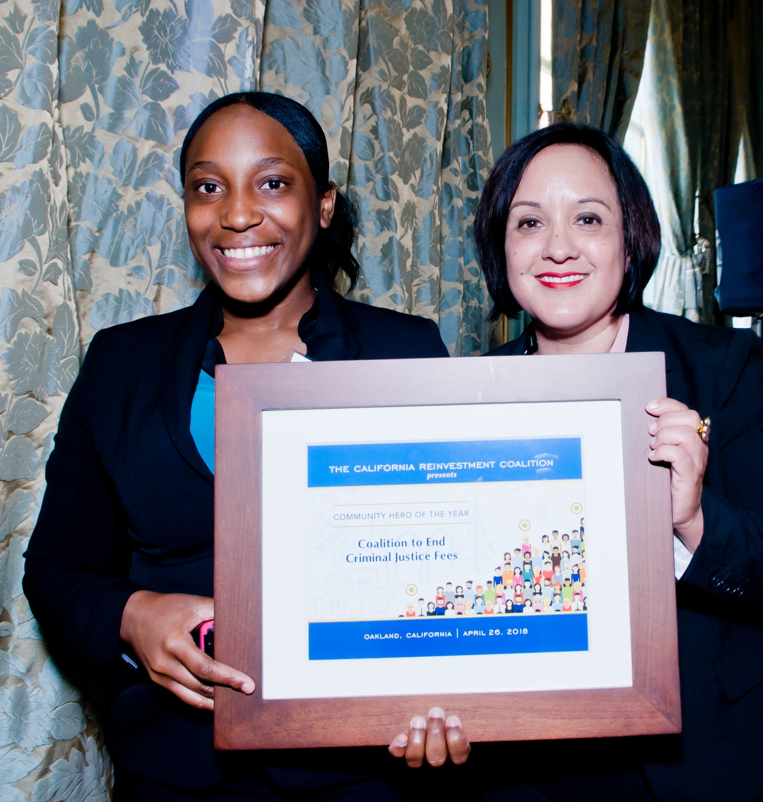- D'Ana (left) accepts an award on behalf of the SB 190 coalition from the CA Reinvestment Coalition on April 26th, 2018.