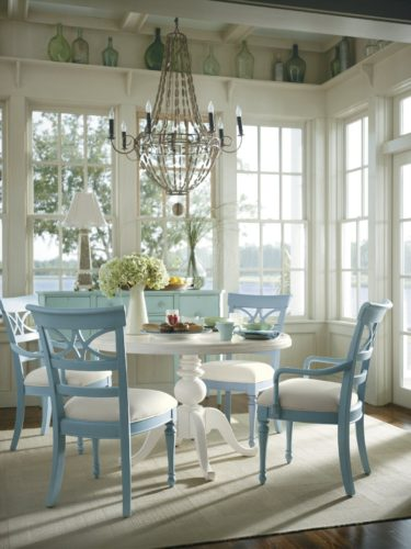 A simple round table, easily available, painted white with fresh morning blue chairs. Source: Pinterest