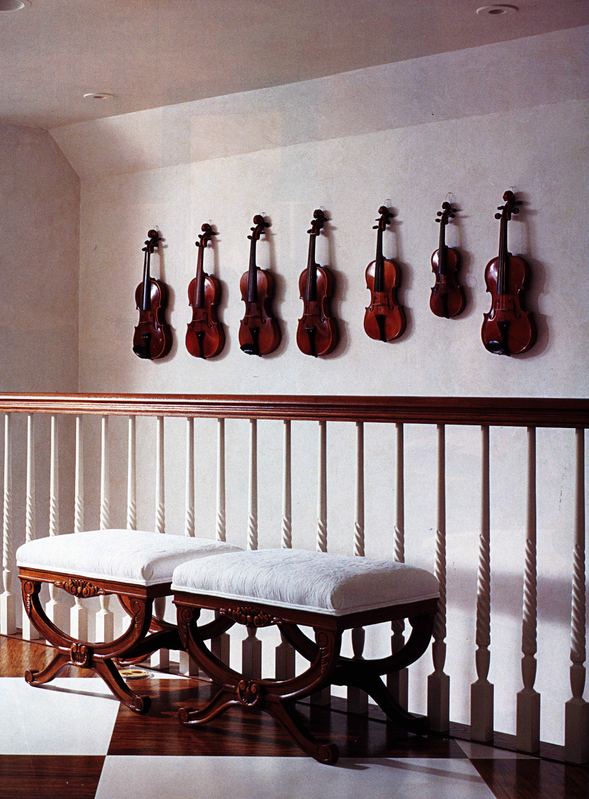 A beautiful, traditional landing with a collection of violins adding to the atmosphere of the space. Source: Unknown