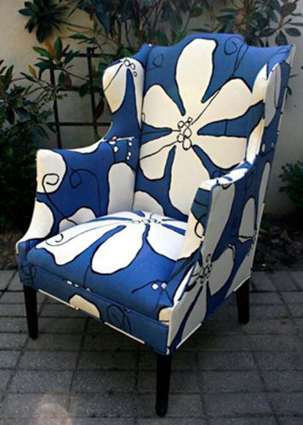 A boldly upholstered wing back chair to complement a cream coloured sofa. Source: Chairloom Upholstery (USA)