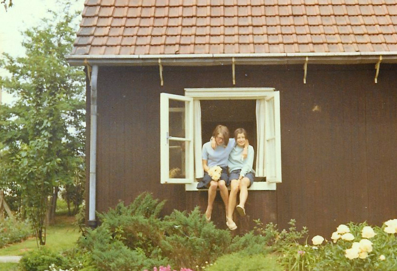 As teenagers, my youngest sister and I. An old photo, so not great quality.