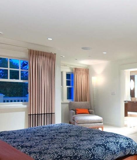 Design: Sophistique Interior Design. Foscarini's Mite is shown near the lounge chair in the corner.