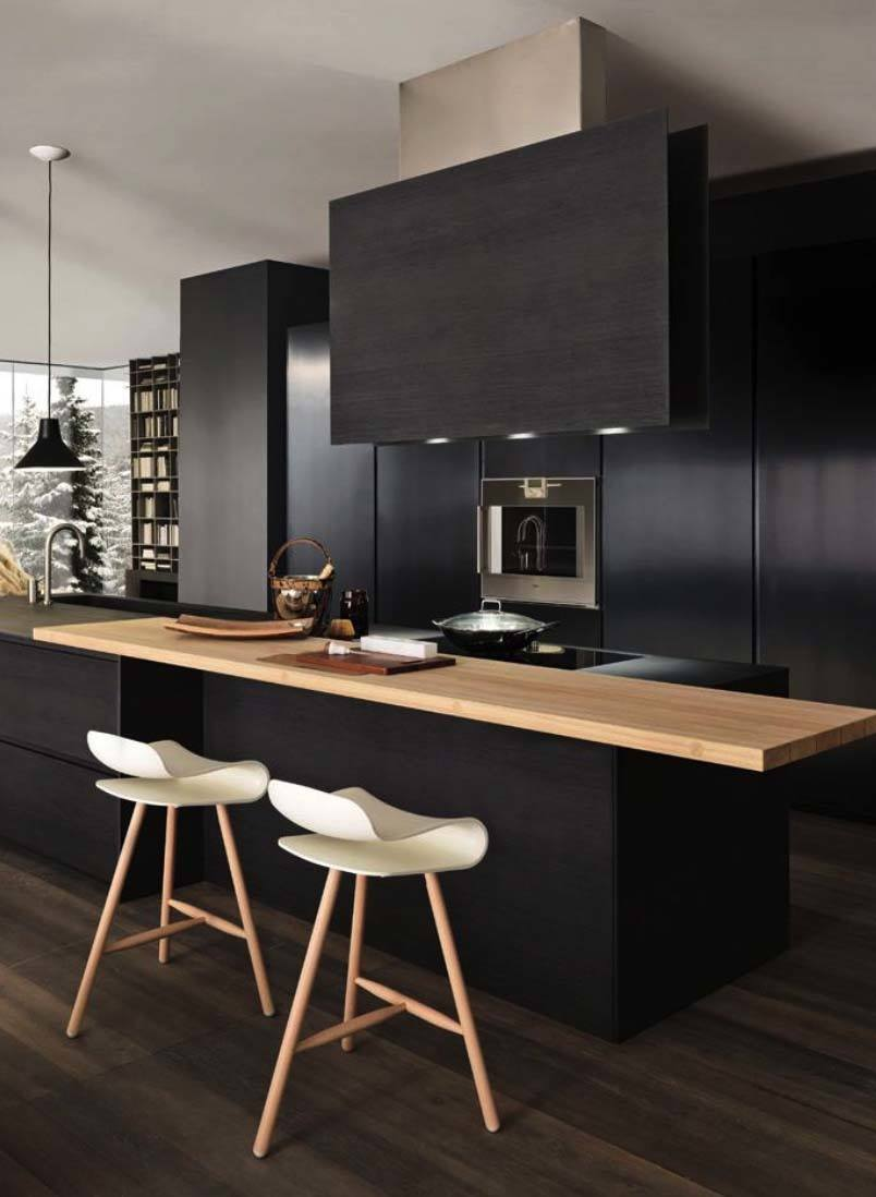 A Modulnova Kitchen (Italy). Contemporary and elegant, I particularly like how the natural light wood softens the look of the black finish.