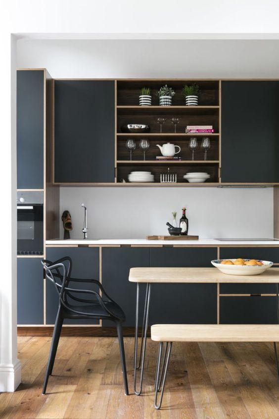 Simple, yet elegant! Note the outline of the cabinets in a different colour which is subsequently reflected in the light toned wood floor and table with bench. Small, but practical. Source: Pinterest