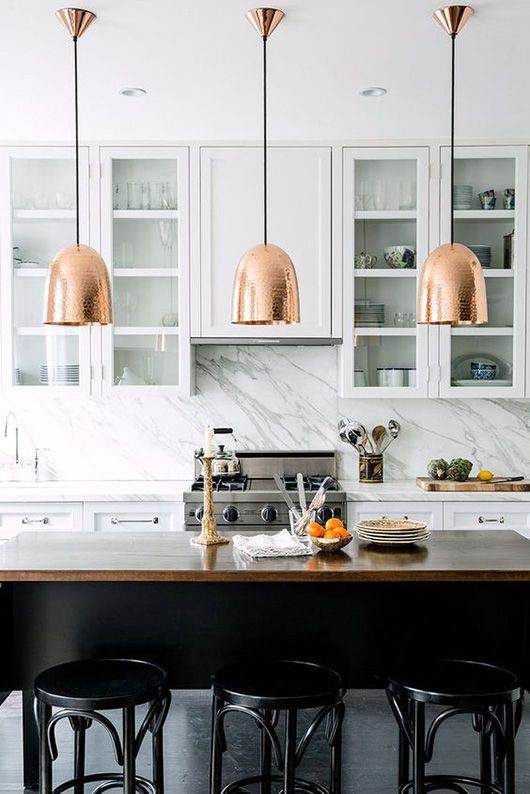 Source: Pinterest. I like the rose coloured tone of the pendants in this kitchen. They stand out and at the same time reflect the wood island top. The Thonet style barstools finish the look quite wonderfully. All simple elements but with a huge amount of impact.